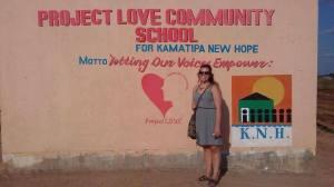 female student standing outside community school in zambia