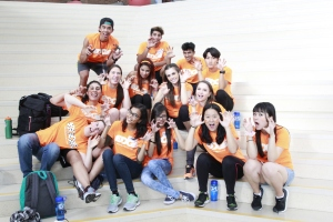 EDGE group wearing orange shirts and making silly faces
