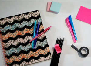 table with chevron print notebook and school supplies