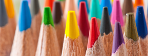 a close-up image of many coloured pencil crayons